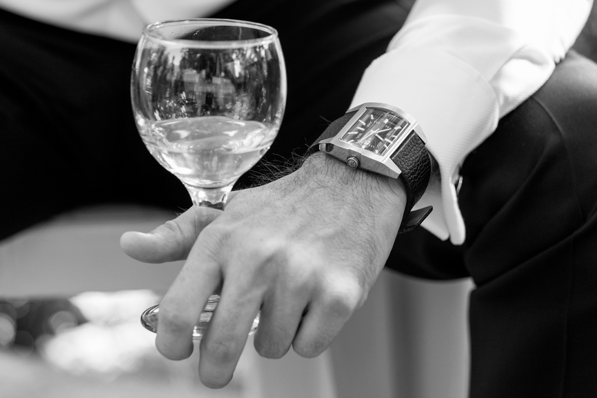 d0d8ab5a580 Closeup of groom and business man with glass of wine and watch